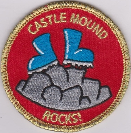 Castle Mound rocks badge